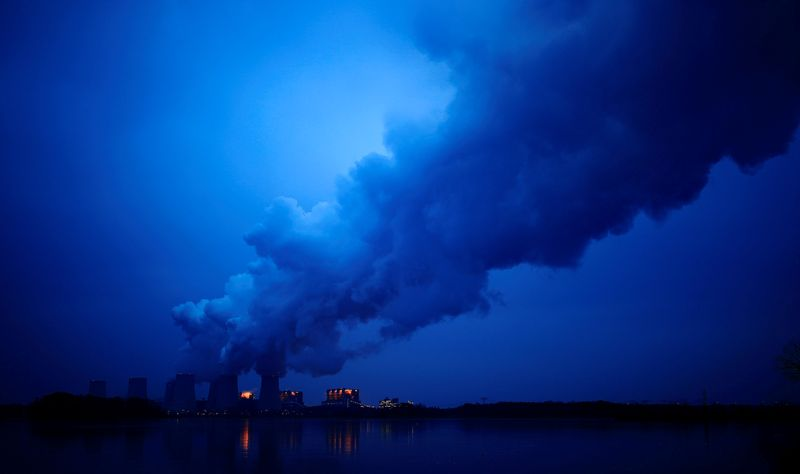 FILE PHOTO: Water vapour rises from the cooling towers of the Jaenschwalde lignite-fired power