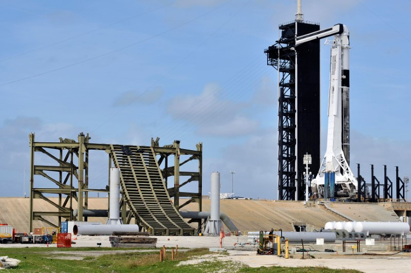 The SpaceX Crew Dragon capsule sits atop a Falcon 9 booster rocket on Pad 39A at Kennedy Space