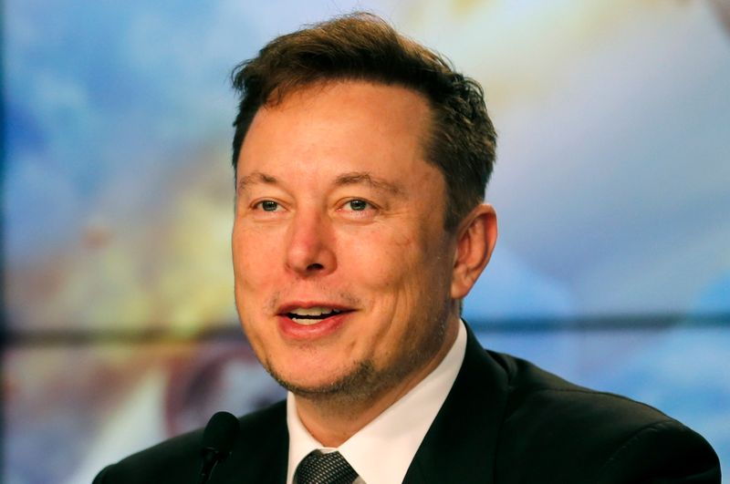 SpaceX founder and chief engineer Elon Musk speaks at a post-launch news conference to discuss