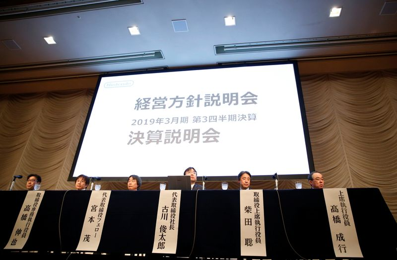 Nintendo President Furukawa and other company executives attend a news conference in Tokyo