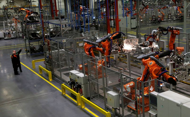 FILE PHOTO: Robots work on a 2013 Mini at BMW's plant in Oxford, southern England