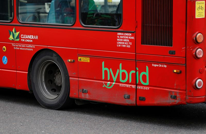 A hybrid sign on the side of a bus is pictured in London