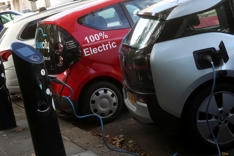FILE PHOTO: Electric cars are charged at Source power points in London