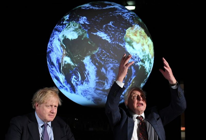 British Prime Minister Boris Johnson sits with David Attenborough during a conference about
