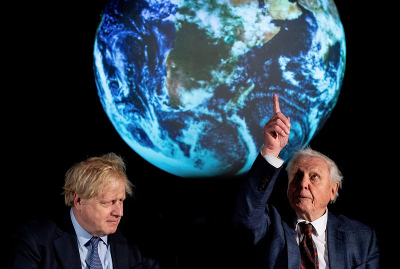 British Prime Minister Boris Johnson and David Attenborough attend a conference about the COP26