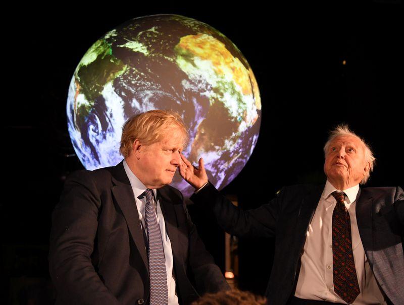 British Prime Minister Boris Johnson and David Attenborough attend a conference about COP26 UN