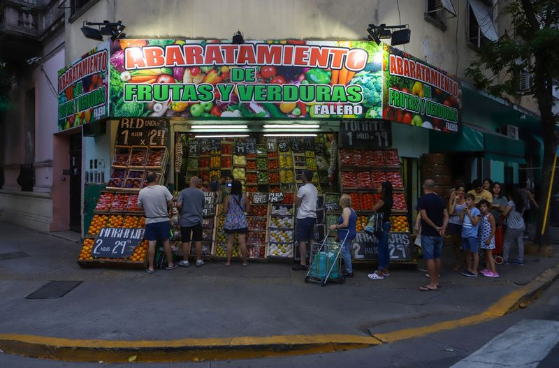 People buy fresh products at a store in the district of Flores where Pope Francis grew up, in