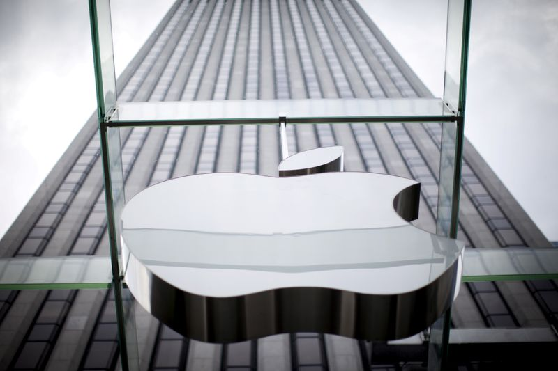 FILE PHOTO: An Apple logo hangs above the entrance to the Apple store on 5th Avenue in the