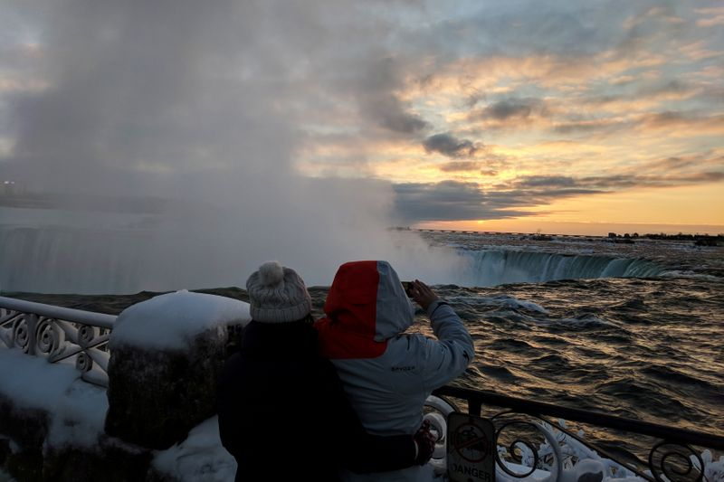 FILE PHOTO: Visitors take pictures near the brink of the ice covered Horseshoe Falls in Niagara