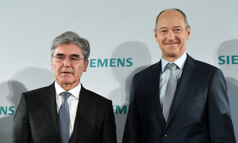 German engineering group Siemens CEO Joe Kaeser and deputy CEO Roland Busch attend a news