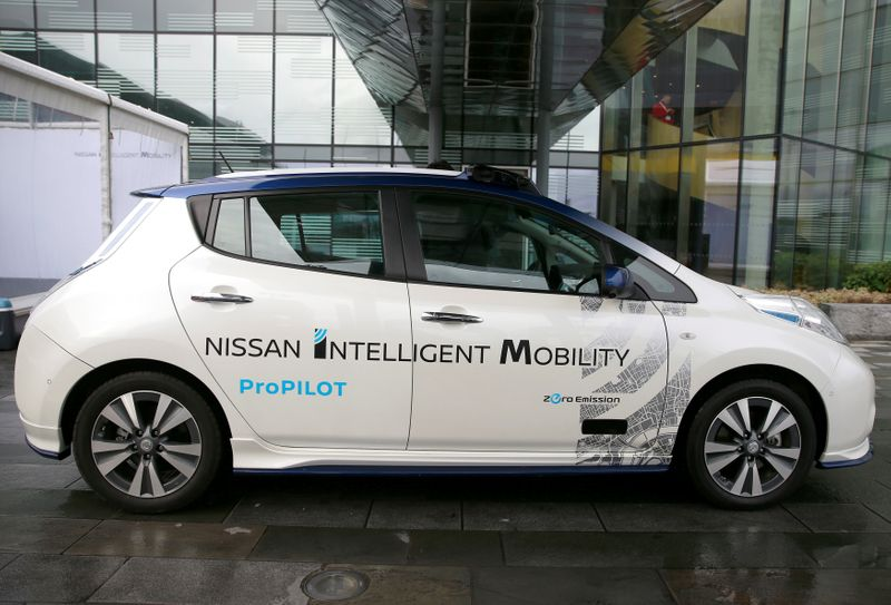 FILE PHOTO: A modified Nissan Leaf, driverless car, is seen during a pause in its first