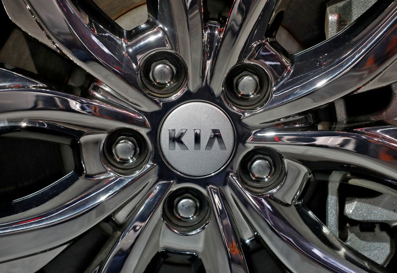 The logo of Kia Motors is seen on a wheel of its Carnival car at the India Auto Expo 2020 in