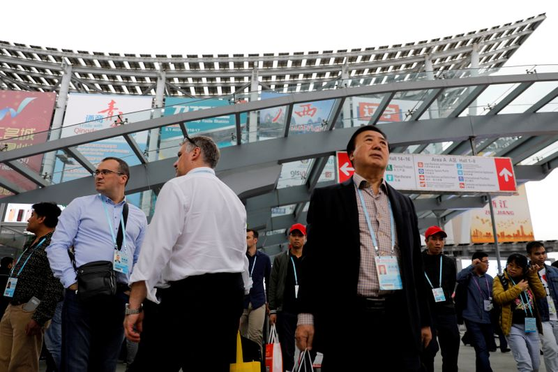 FILE PHOTO: Visitors attend the China Import and Export Fair, also known as Canton Fair, in the