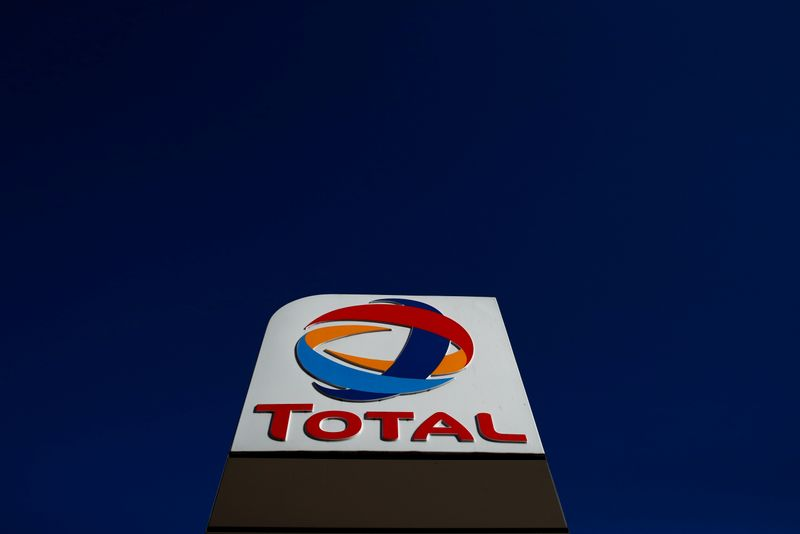 The logo of French oil and gas company Total is seen in a petrol station in Paris