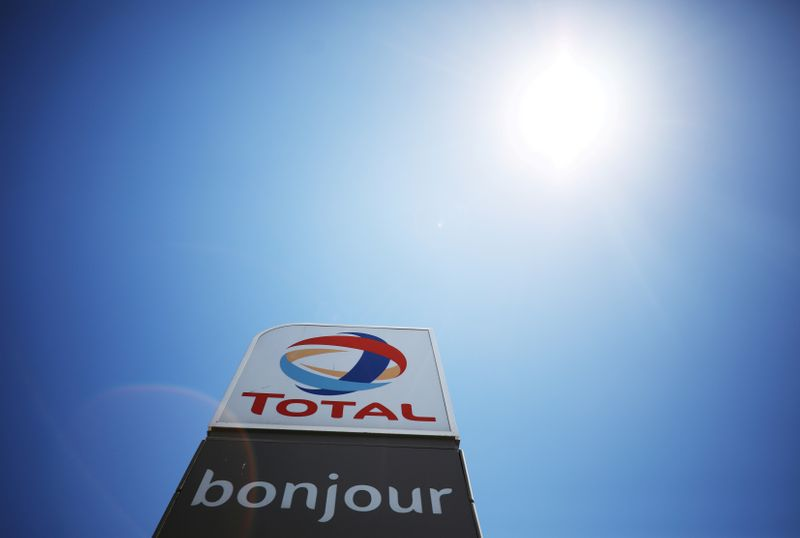 FILE PHOTO: The logo of French oil and gas company Total is seen above a petrol station in Cape