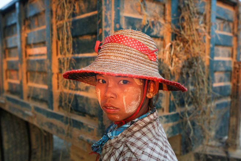 A worker is seen at the melon packing site after harvesting in the farm in Madauk, Bago