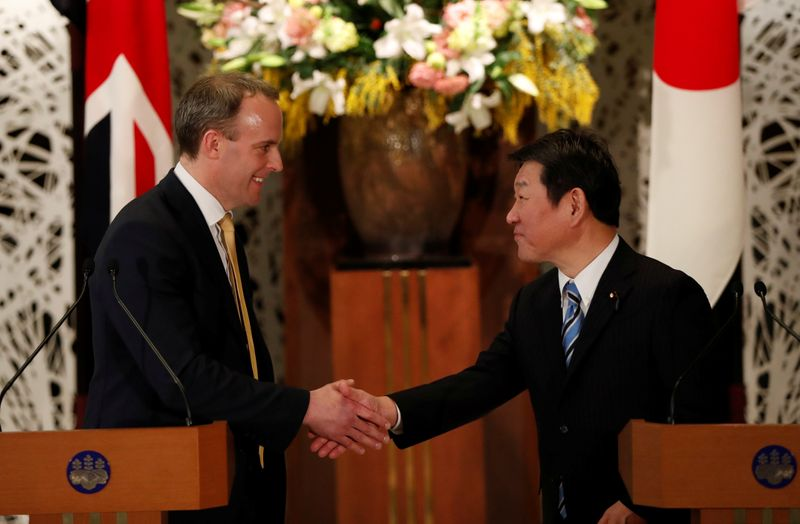 British Foreign Secretary Dominic Raab and Japanese Foreign Minister Toshimitsu Motegi attend