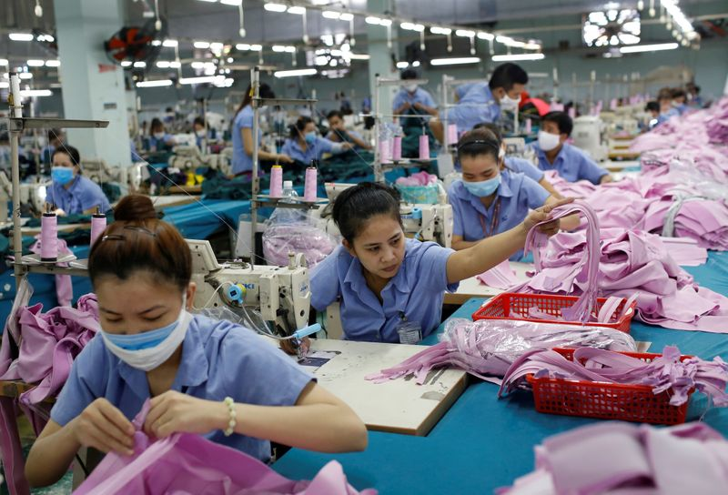 FILE PHOTO: Labourers work at a garment assembly line of Thanh Cong textile, garment,