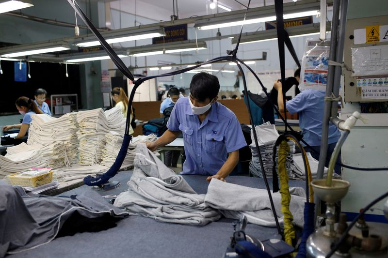 FILE PHOTO: A man works at a garment assembly line of Thanh Cong textile, garment, investment