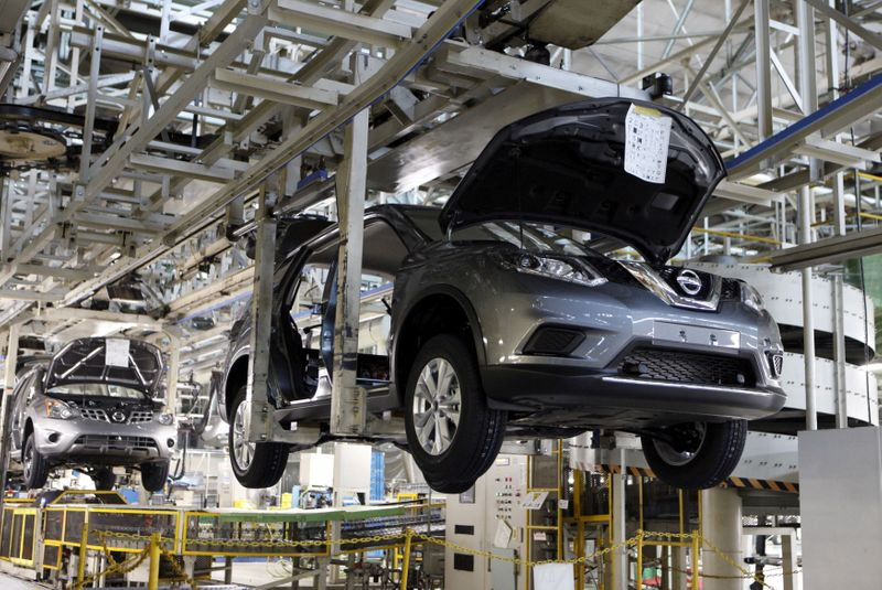 FILE PHOTO: Vehicles of Nissan Motor Co. move on the assembly line at the company's Kyushu