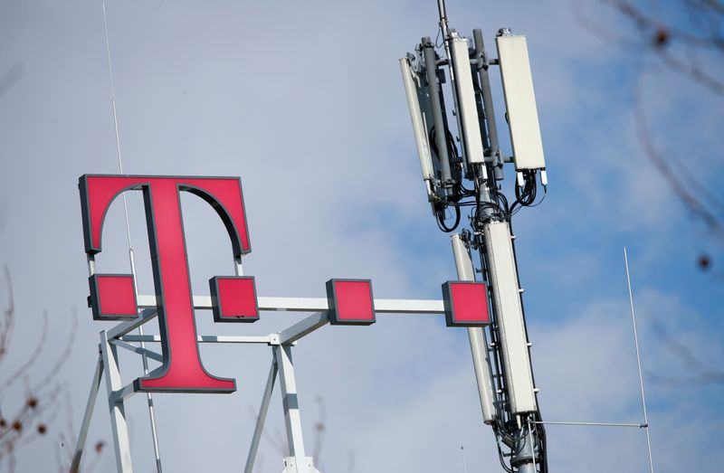 Logo of German telecommunications giant Deutsche Telekom AG and GSM antennas are seen atop of