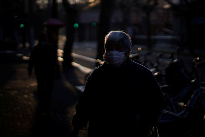 A man wearing a mask is seen in downtown Shanghai