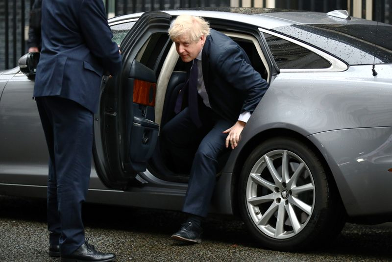 Britain's Prime Minister Boris Johnson arrives at Downing Street in London