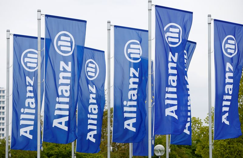 Flags with the logo of Allianz SE, Europe's biggest insurer, are pictured before the company's