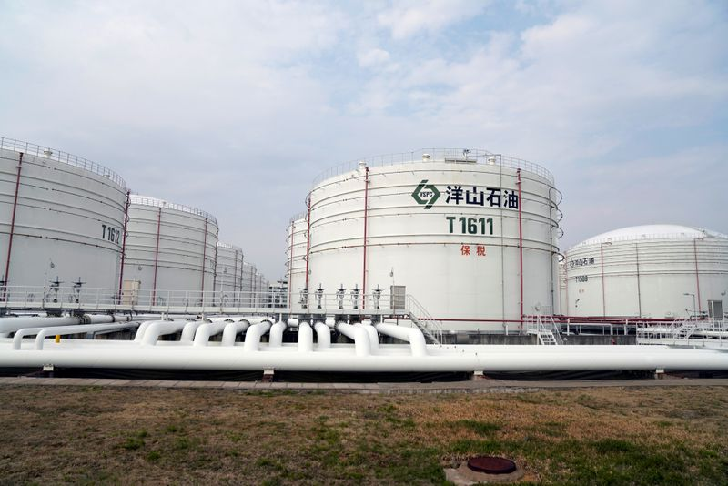 Oil tanks are seen at an oil warehouse at Yangshan port in Shanghai