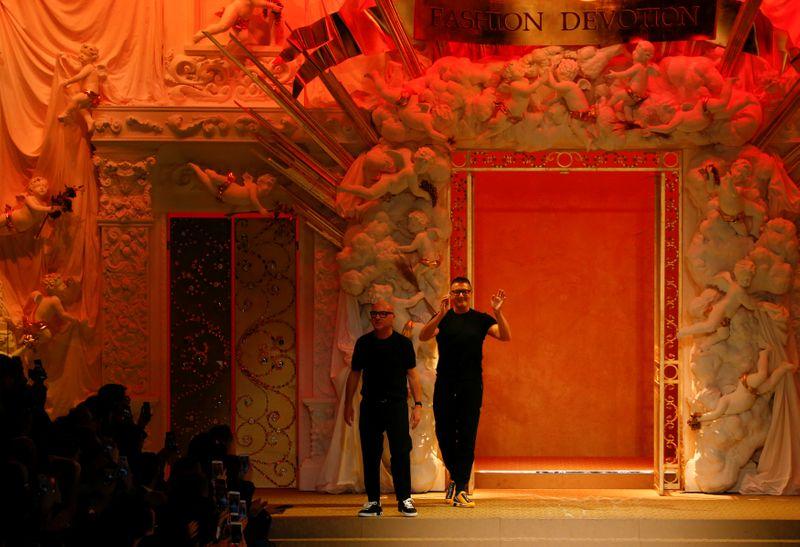 FILE PHOTO:  Italian designers Domenico Dolce and Stefano Gabbana acknowledge the applause at