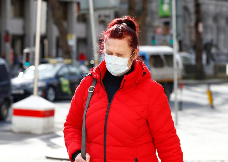 A woman wearing a face mask on St. Patrick's Day as public events were cancelled due to the
