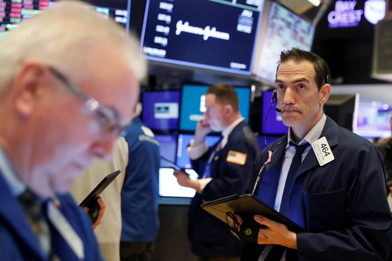 Traders work on the floor of the New York Stock Exchange shortly after the opening bell as