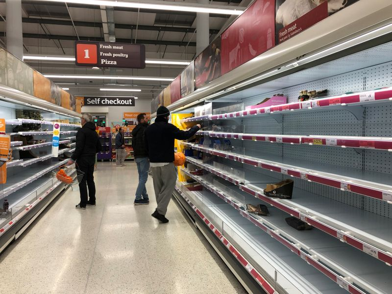 Empty shelves are seen at a Sainsbury's store in south London as the numbers of coronavirus