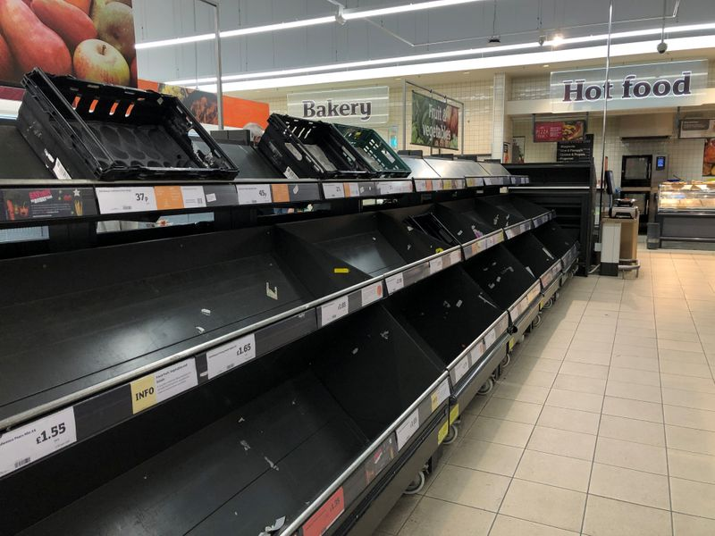 Empty shelves are seen inside Sainsbury's Lee Green in London