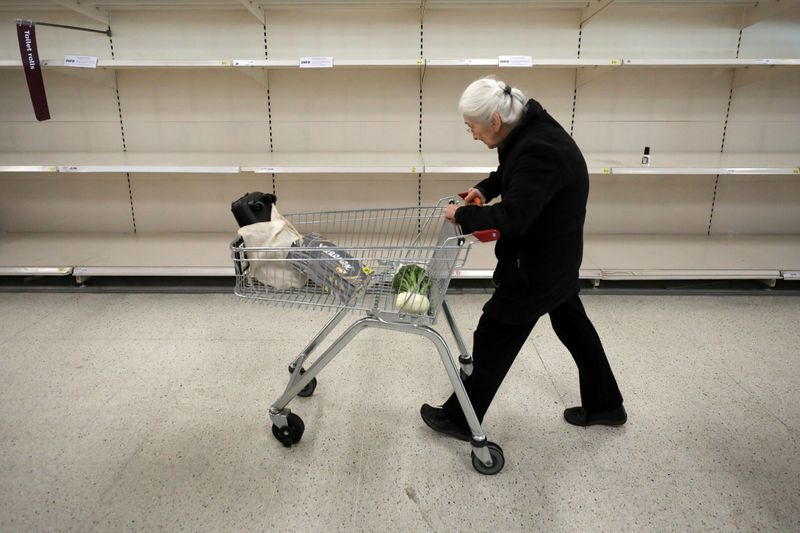People are seen at the fruit and vegetable aisle in Sainsbury's supermarket