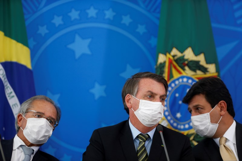 A family wears protective face masks at international arrivals area at Guarulhos International