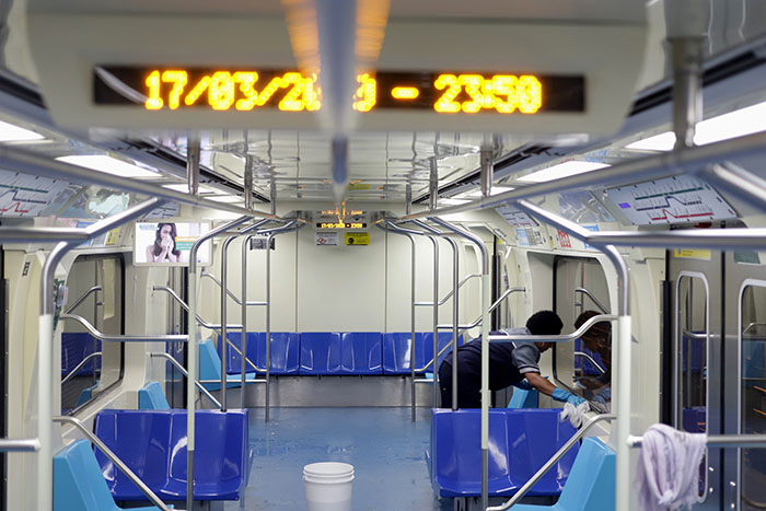 A cleaner works on the disinfection of a subway train as a measure against the coronavirus