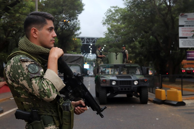 Paraguayan soldiers patrol the Friendship Bridge that connects Ciudad del Este in Paraguay with