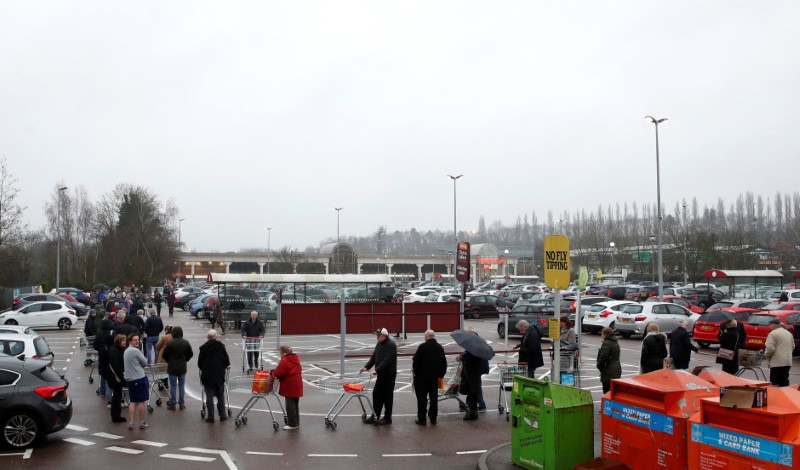 People queue outside of a Waitrose supermarket in St Albans