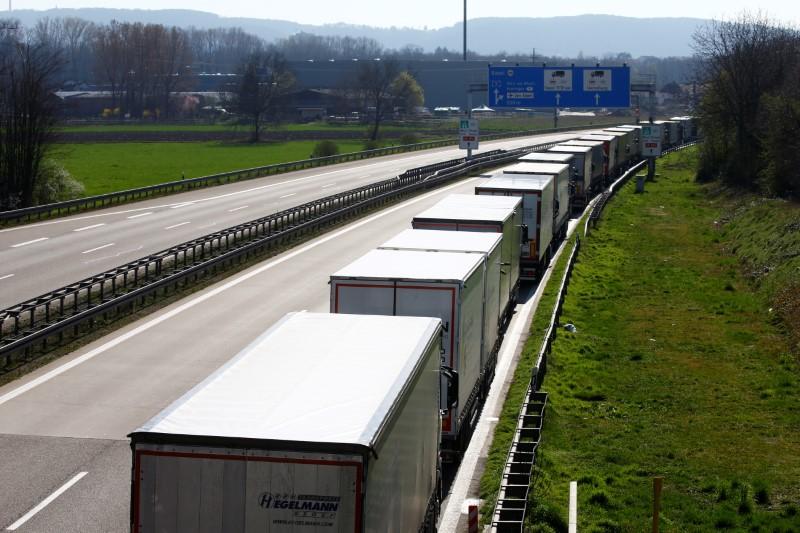 FILE PHOTO:  Trucks parked near German-Swiss border in Weil am Rhein