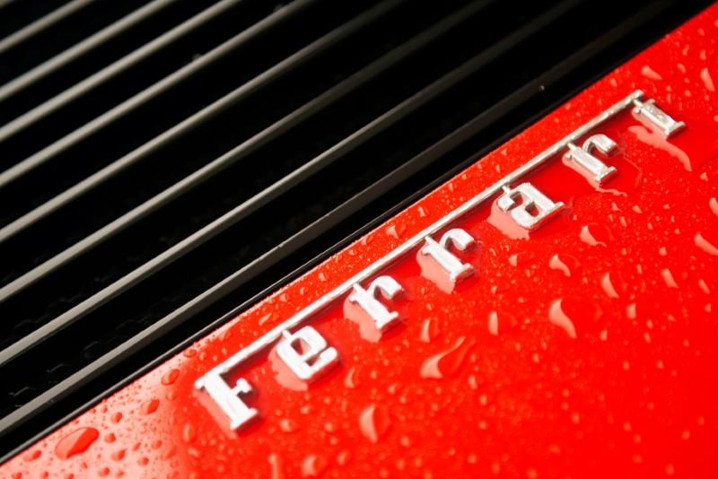 FILE PHOTO: The Ferrari insignia on a Ferrari Testarossa sports car