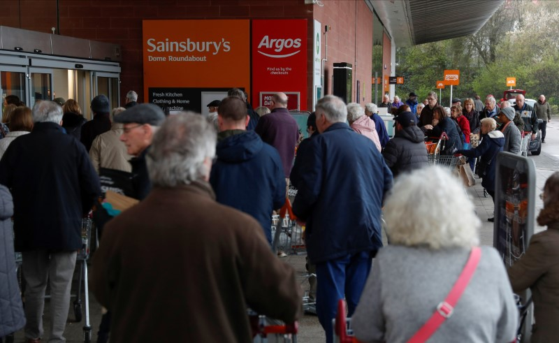 People queue outside a supermarket during the spread of coronavirus disease (COVID-19) in