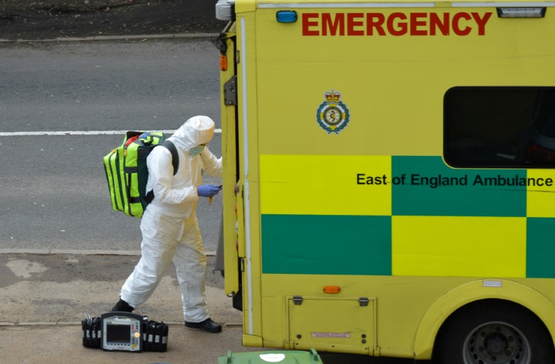 FILE PHOTO: A paramedic is seen in Cheshunt at the back of an ambulance as the spread of the