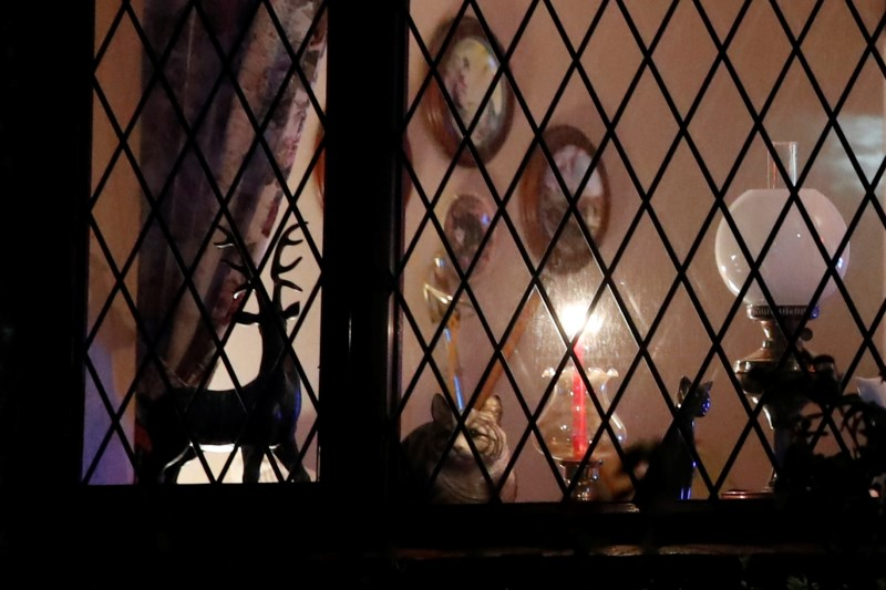 A candle is seen in the window of a house in Milton Keynes.
