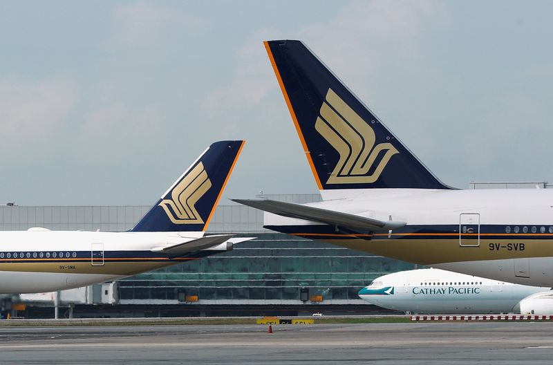 FILE PHOTO: Singapore Airlines planes are pictured on the tarmac at Changi Airport, Singapore