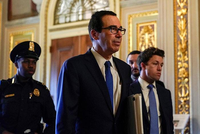 U.S. Secretary of the Treasury Mnuchin walks to the meeting for a coronavirus relief package in