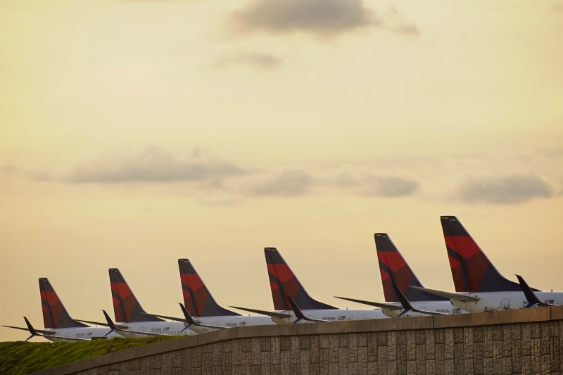 FILE PHOTO: Delta Air Lines passenger planes are seen lined up on a runway in Atlanta