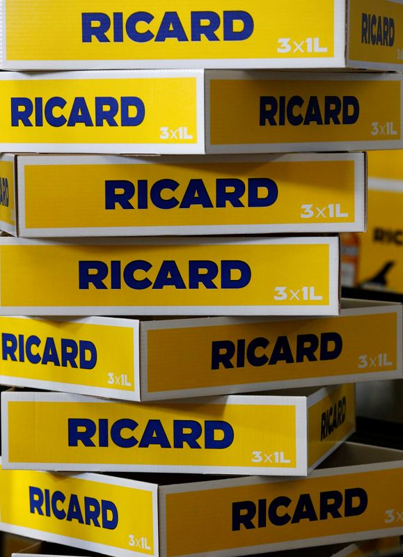 FILE PHOTO: Boxes of bottles of Ricard's aniseed-flavoured beverage are pictured at the Ricard