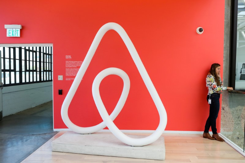 FILE PHOTO: A woman talks on the phone at the Airbnb office headquarters in the SOMA district