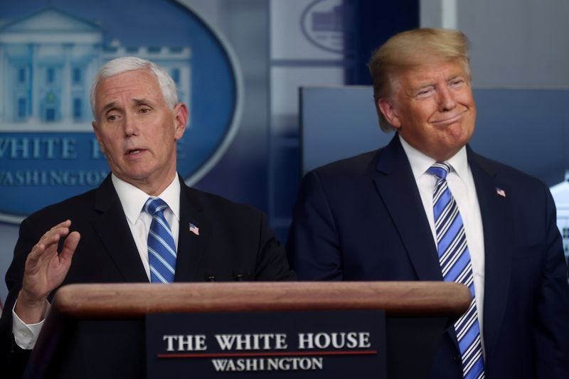 FILE PHOTO: U.S. President Trump, with Pence, leads the daily coronavirus response briefing at